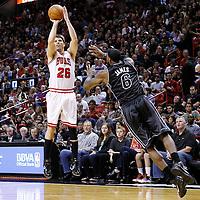 29 January 2012: Chicago Bulls shooting guard Kyle Korver (26) takes a 3-points jumpshot over Miami Heat small forward LeBron James (6) during the Miami Heat 97-93 victory over the Chicago Bulls at the AmericanAirlines Arena, Miami, Florida, USA.