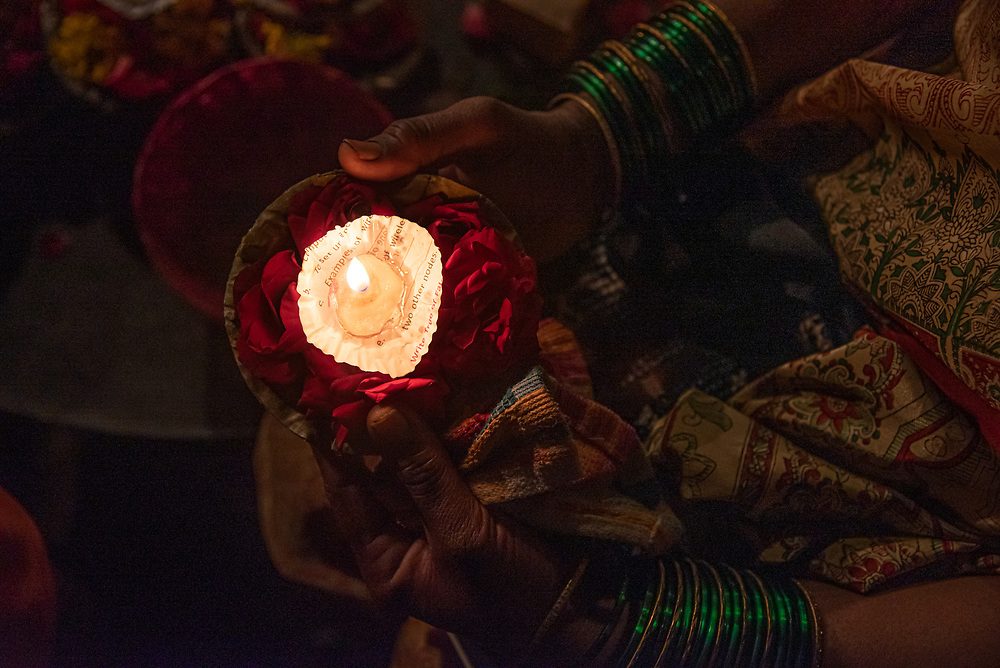 Women light dia ( candles) and place them on rose petals to leave them in the holy river Ganga in Varanasi, India on 08/09/2019. Photo by Akash Pamarthy.