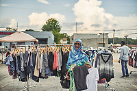 Amina Osman, a refugee from Somalia, shops at the annual refuge shopping event at Refuge Coffee in Clarkston, GA. Part of a documentary series on Clarkston, GA.  The most ethnically diverse square mile in America, there are over 70 nationalities that have sought refuge there since the 1980s.
