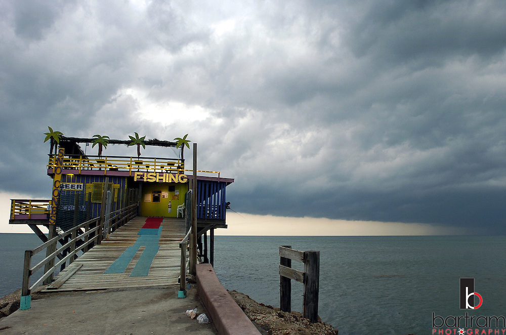 KEVIN BARTRAM/The Daily News.Storm clouds pass over the 61st Street fishing pier early Wednesday morning, June 1, 2005 as rain passes over Galveston and into the Gulf of Mexico.