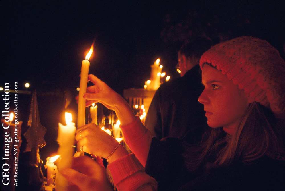 Vietnam War protesters with candles at night.