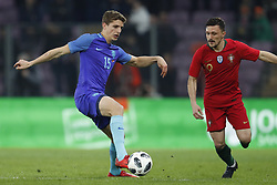 (L-R) Guus Til of Holland, Mario Rui of Portugal during the International friendly match match between Portugal and The Netherlands at Stade de Genève on March 26, 2018 in Geneva, Switzerland