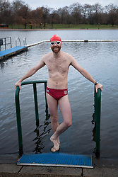 © Licensed to London News Pictures. 25/12/2011. LONDON, UK. Serpentine Swimmer Neil Price, prepares to carry out his Christmas Day Swim in the Serpentine in London today (25/12/11). Members of the Serpentine Swimming Club today carried out their Christmas Day Swim, the race, known as the Peter Pan Cup after former patron and author JM Barrie, is a tradition dating back to 1864. Photo credit: Matt Cetti-Roberts/LNP