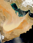 A dense wall of dust barrelled across the Arabian Peninsula on March 26-27, 2011. The massive storm stretches more than 500 kilometres (300 miles) across the peninsula, covering parts of Saudi Arabia, Yemen, Oman, and the United Arab Emirates. This pair of images from the Moderate Resolution Imaging Spectroradiometer (MODIS) shows the storm's progression in a 22-hour period. The MODIS sensor on NASA's Aqua satellite captured the top image on March 26, and MODIS on NASA's Terra satellite captured the bottom image on March 27.On March 26, the storm stops short of Oman and Yemen, and the opaque mass of dust is bordered by crystal-clear skies to the south. Some plumes blow across the Persian Gulf toward Iran.