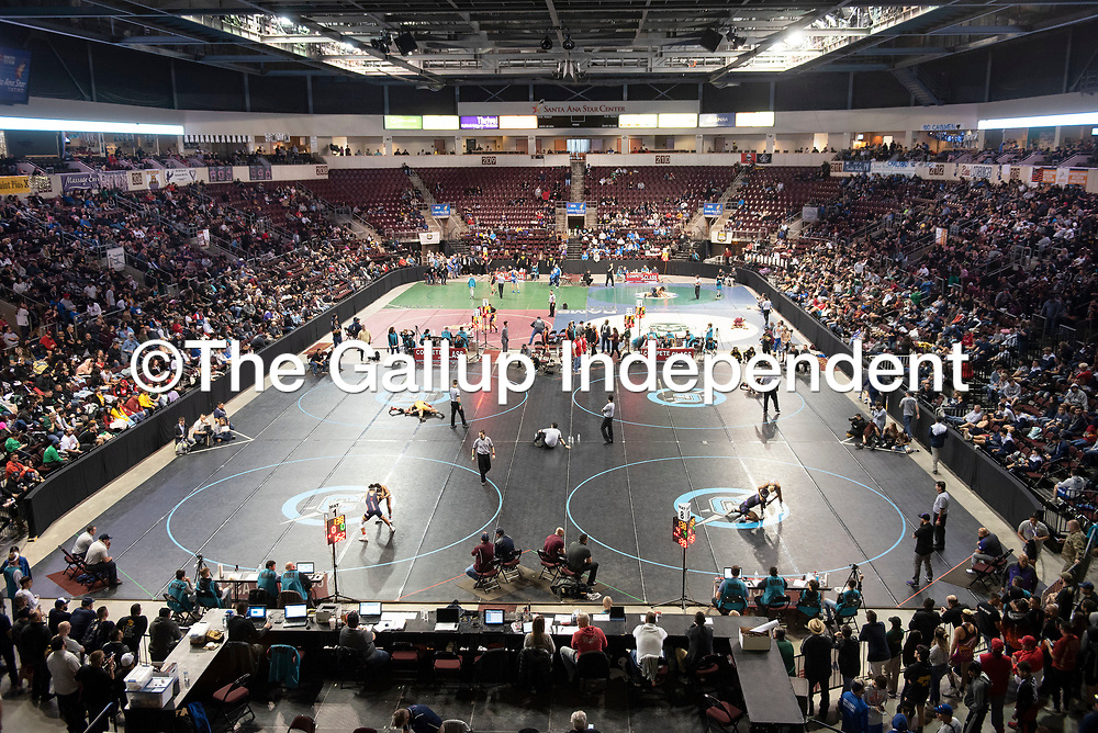 The New Mexico Activities Association State Wrestling Championships began Friday morning at the Santa Ana Star Center in Rio Rancho and continue through Saturday.