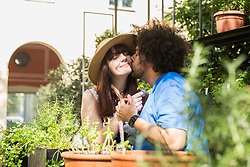 Young couple kissing at herb garden
