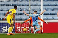 Coventry City forward Conor Chaplin (10) has a stab at the cross from Coventry City midfielder Luke Thomas (23) on loan from Derby County, as Coventry City score a goal to draw back to 1-1 during the EFL Sky Bet League 1 match between Coventry City and AFC Wimbledon at the Ricoh Arena, Coventry, England on 12 January 2019.