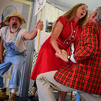 """Redwulf Dancingbare, left, interrupts a scene between Karen Pettit and George Dobbs during a rehearsal for the play """"Little Nell and the Mortgage Foreclosure"""" Wednesday at Old School Gallery in El Morro."""