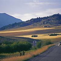 Bridger Mountains, near Bozeman, Montana. A car drives on Jackson Creek Road below Saddle Peak.