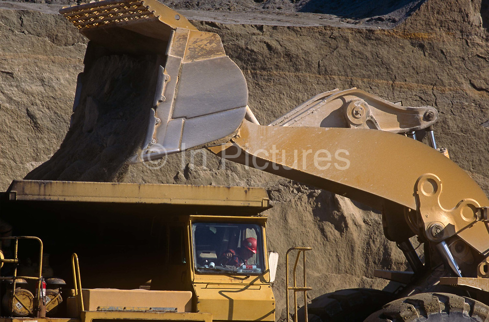 A tipper drops aggregates into a dumpster at a facility owned by Hanson, on 17th April 1999, at Chipping Sodbury, England.