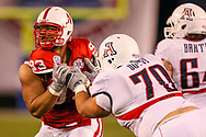Ndamukong Suh tries to shed the block of Arizona's Vaughn Dotsy during a 33-0 win in the Holiday Bowl on Dec. 30, 2009. © Aaron Babcock
