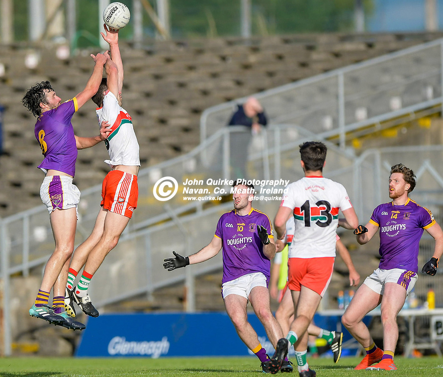 Philip Ward, claims a high ball for Gaeil Colmcille,   in the Gaeil Colmcille v Wolfe Tones, 2020 Feis Cup Final match, at Páirc Tailteann, Navan.<br /> <br /> Photo: GERRY SHANAHAN-WWW.QUIRKE.IE<br /> <br /> 02-08-2021
