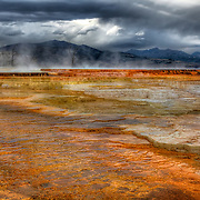 Evening storm clouds after a rain gave a moody feel to the already eerie terraces at Mammoth Hot Springs