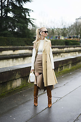 March 4, 2018 - Paris, France - Tatiana Korsakova wears a sleeveless beige trench coat, brown boots, a bag, a white wool off shoulder top, outside Valentino, during Paris Fashion Week Womenswear Fall/Winter 2018/2019, on March 4, 2018 in Paris, France. (Credit Image: © Nataliya Petrova/NurPhoto via ZUMA Press)