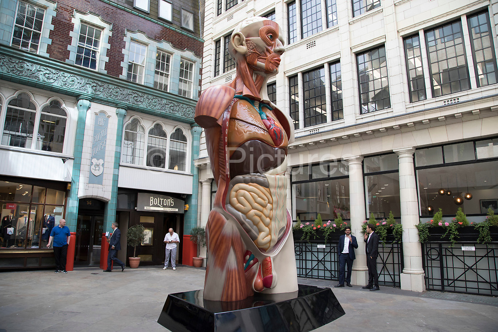 Sculpture in the City on July 17th 2017 in the City of London, England, United Kingdom. Each year, the critically acclaimed Sculpture in the City returns to the Square Mile with contemporary art works from internationally renowned artists in a public exhibition of artworks  open to everyone to come and interact with and enjoy. Temple by Damien Hirst 2008.