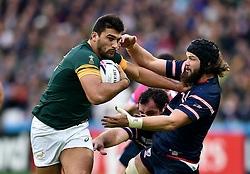 Damian de Allende of South Africa fends Daniel Barrett of the USA - Mandatory byline: Patrick Khachfe/JMP - 07966 386802 - 07/10/2015 - RUGBY UNION - The Stadium, Queen Elizabeth Olympic Park - London, England - South Africa v USA - Rugby World Cup 2015 Pool B.