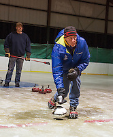 Guy Knowlton looks on as Mike Ware throws his stone for the white team during the weekly curling tournament at the Gilford Ice Rink with Gilford Parks and Rec on Thursday evenings.  (Karen Bobotas/for the Laconia Daily Sun)