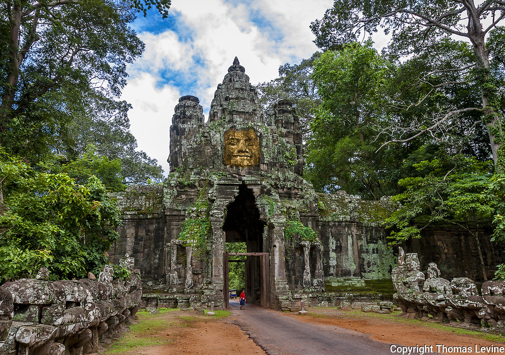 One small child at the entry tunnel of Angkor Thom