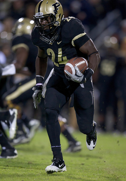 October 01, 2011:  Purdue running back Akeem Shavers (#24) runs for yardage during NCAA Football game action between the Notre Dame Fighting Irish and the Purdue Boilermakers at Ross-Ade Stadium in West Lafayette, Indiana.  Notre Dame defeated Purdue 38-10.