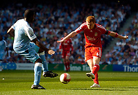 Photo: Jed Wee/Sportsbeat Images.<br /> Manchester City v Liverpool. The Barclays Premiership. 14/04/2007.<br /> <br /> Liverpool's John Arne Riise (R) fires in a low drive in one of their few chances.