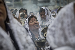 October 6, 2018 - Lima, Peru - Devotees participate in a procession of the Lord of the Miracles most know as El Senr de los Milagrosa in Lima Peruvian capital. Every October for the past four centuries this procession takes place in Lima and is known as the most important religious event in Peru. This Peruvian tradition commemorates the devastating 1746 Lima earthquake which left only a mural of Christ standing in a city area. (Credit Image: © Guillermo Gutierrez/SOPA Images via ZUMA Wire)