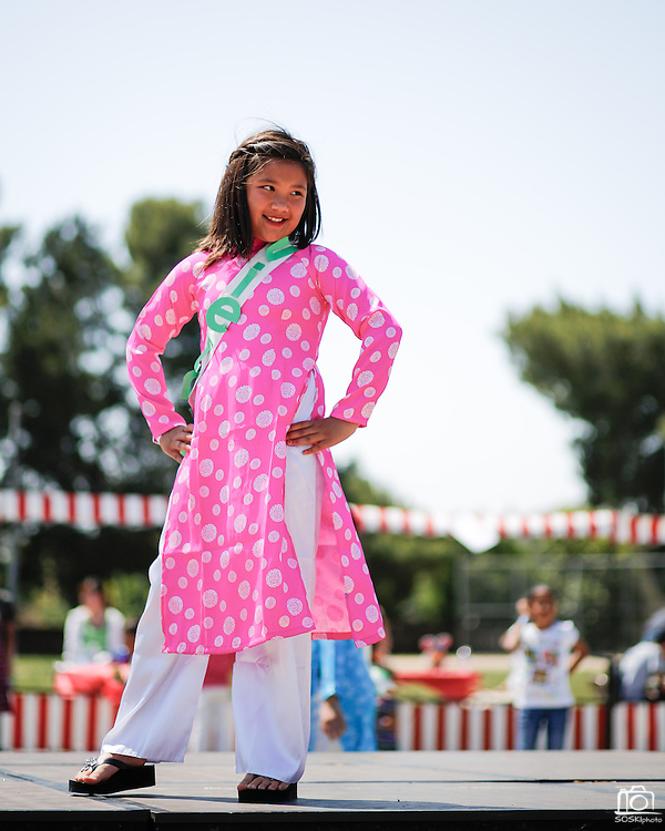 Lauren Young, 9, wears traditional Vietnamese clothing during the fashion show at the First Annual Multicultural Festival at Pomeroy Elementary School in Milpitas, California, on April 27, 2013. (Stan Olszewski/SOSKIphoto)