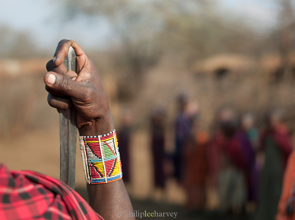 Maasai tribesman with hand on spear, Tipilit Village, near Amboseli National Park, Kenya