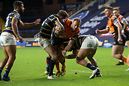 No way through for Liam Watts of Castleford as the Leeds Rhinos defence holds firm during the Betfred Super League match between Leeds Rhinos and Castleford Tigers at Emerald Headingley Stadium, Leeds, United Kingdom on 26 October 2020.