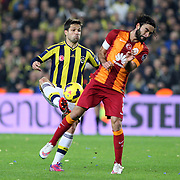 Fenerbahce's Diego Ribas (L) and Galatasaray's Selcuk Inan (R) during their Turkish superleague soccer derby Fenerbahce between Galatasaray at the Sukru Saracaoglu stadium in Istanbul Turkey on Sunday 08 March 2015. Photo by Kurtulus YILMAZ/TURKPIX