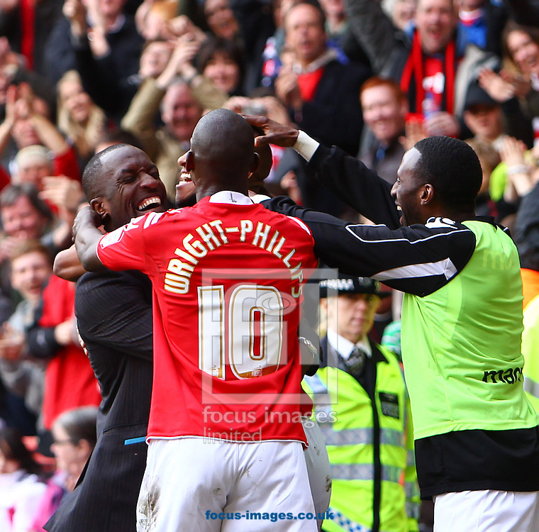Picture by John Rainford/Focus Images Ltd. 07506 538356.05/05/12.Danny Haynes of Charlton Athletic is congratulated by Bradley Wright-Phillips, Jason Euell and manager Chris Powell after he put his team in front against Hartlepool United during the Npower League 1 match at The Valley stadium, London.
