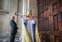 © Licensed to London News Pictures. 12/05/2018. London, UK. The Rt Revd and Rt Hon Dame Sarah Mullally DBE knocks on the door of Saint Paul's Cathedral as she arrives for a service which will install her as the 133rd Bishop of London.  The service coincides with International Nurses Day, Florence Nightingale's birthday, echoing Bishop Sarah's own former career in the NHS as a nurse, including as Chief Nursing Officer, before her ordination. Photo credit: Rob Pinney/LNP
