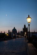 Charles Bridge and the view to Prague Old Town during the early morning change from night to day.