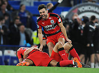 Football - 2017 / 2018 Premier League - Chelsea vs. Huddersfield Town<br /> <br /> Huddersfield players celebrate at the final whistle after surviving in the Premiership for next season at Stamford Bridge.<br /> <br /> COLORSPORT/ANDREW COWIE