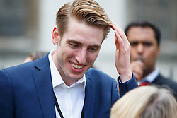 © Licensed to London News Pictures. 12/09/2015. London, UK. Newly elected Labour Party leader Jeremy Corbyn's son Benjamin Corbyn attending a pro-refugee march in central London following his victory on September 12, 2015. Photo credit: Tolga Akmen/LNP