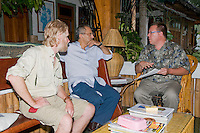Professor Hinrich Kaiser of Victor Valley College, Victorville, California (right), presents his Initial Report on the Herpetofauna of Timor-Leste to President Jose Ramos-Horta (center) at the President's home in Dili on February 4, 2010.  Professor Kaiser and his students are conducting the first scientific survey of the reptiles and amphibians of Timor-Leste (East Timor). Seated at left is British herpetologist Mark O'Shea, a participant in the research project.