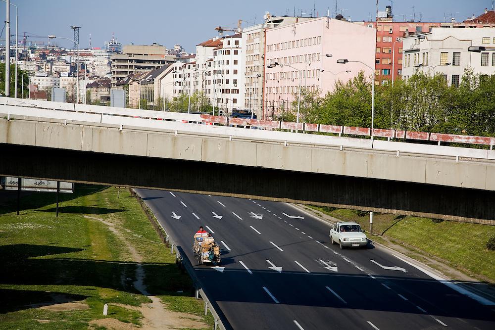 Scenes from Belgrade, Serbia..Roma push carts down a major thoroughfare near the center of Belgrade.
