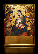 Gothic painted Panel Virgin Suckling the Child by Llorenc Saragossa. Tempera, gold leaf and metal plate on wood. Last quarter of 14th century. Dimensions 196.7 x 148.4 x 9.5 cm.  It comes from Albarracín cathedral (Teruel).  National Museum of Catalan Art, Barcelona, Spain, inv no: 005080-000 .<br /> <br /> If you prefer you can also buy from our ALAMY PHOTO LIBRARY  Collection visit : https://www.alamy.com/portfolio/paul-williams-funkystock/romanesque-art-antiquities.html<br /> Type -     MNAC     - into the LOWER SEARCH WITHIN GALLERY box. Refine search by adding background colour, place, subject etc<br /> <br /> Visit our ROMANESQUE ART PHOTO COLLECTION for more   photos  to download or buy as prints https://funkystock.photoshelter.com/gallery-collection/Medieval-Romanesque-Art-Antiquities-Historic-Sites-Pictures-Images-of/C0000uYGQT94tY_Y