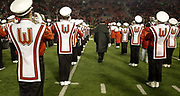 University of Wisconsin-Madison Marching Band Director Mike Leckrone walks between playing band members during the 5th quarter. Leckrone is retiring after 50 years of directing the UW band. (AP Photo/Andy Manis)