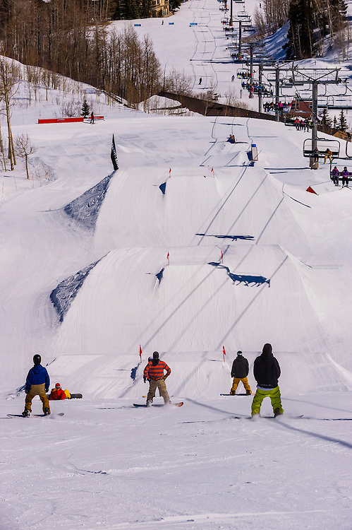 Snowboarders, Snowmass Terrain Park, Snowmass/Aspen ski resort, Snowmass Village (Aspen), Colorado USA.