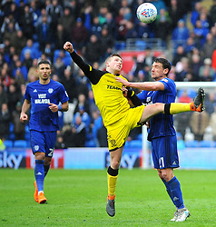 Craig Bryson of Cardiff City and Jamie Allen of Burton Albion compete for the highball - Mandatory by-line: Nizaam Jones/JMP- 30/03/2018 -  FOOTBALL -  Cardiff City Stadium- Cardiff, Wales -  Cardiff City v Burton Albion - Sky Bet Championship