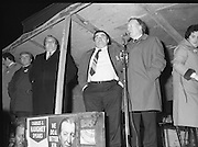 Image of Fianna Fáil leader Charles Haughey touring West Cork during his 1982 election campaign...04/02/1982.02/04/82.4th February 1982..Triple action:..Charles Haughey, behind two election posters with his image on them, speaks to listeners...