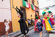 Giant papier mâché puppets called mojigangas dance in the streets during a children's parade celebrating Mexican Independence Day celebrations September 17, 2017 in San Miguel de Allende, Mexico.