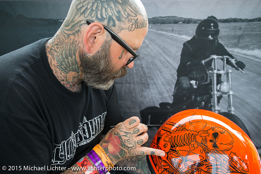 Darren McKeag painting helmets at the Rusty Butcher show during the 75th Annual Sturgis Black Hills Motorcycle Rally.  SD, USA.  August 7, 2015.  Photography ©2015 Michael Lichter.