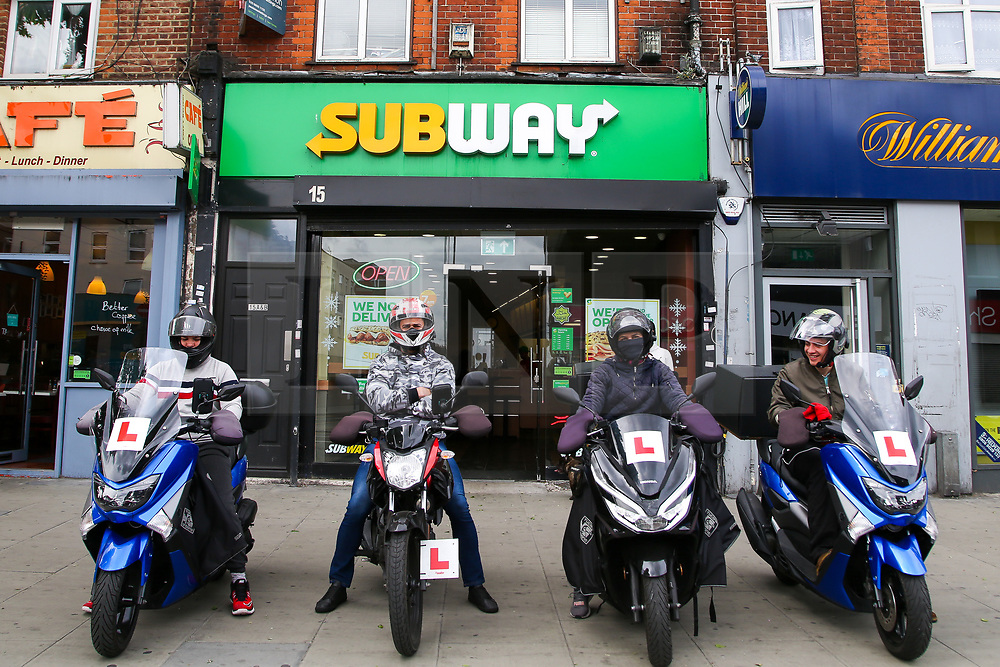 © Licensed to London News Pictures. 22/05/2020. London, UK. Uber delivery drivers wait outside Subway, a fast food restaurant in Wood Green, north London as lockdown restrictions are eased. Photo credit: Dinendra Haria/LNP