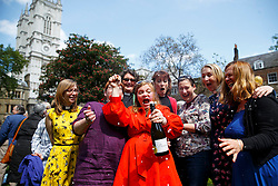 © licensed to London News Pictures. London, UK 03/05/2014. A group of women priests enjoying a bottle of champagne before walking to St Paul's Cathedral from Westminster Abbey in a procession to mark the twentieth anniversary of women becoming ordained priests in the Church of England. Photo credit: Tolga Akmen/LNP