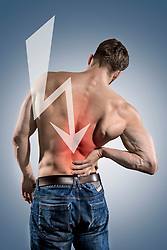 Rear view of shirtless muscular man suffering with lower back pain