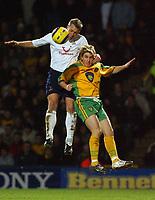 Fotball<br /> Premier League England 2004/2005<br /> Foto: SBI/Digitalsport<br /> NORWAY ONLY<br /> <br /> Barclays Premiership<br /> Norwich City v Tottenham Hotspur<br /> 26/12/2004<br /> <br /> Norwich's Paul McVeigh and Spurs' Erik Edman battle for the ball