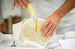 "A slice of soft cheese is cut and removed for tasting during the British Cheese Awards at the Royal Bath & West show in Somerset, where more than 1,000 British cheeses are vying for the title of supreme champion at an event designed to a be a ""great celebration"" of the industry."