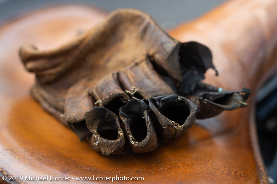Willie Earhart's well worn gloves during the Cross Country Chase motorcycle endurance run from Sault Sainte Marie, MI to Key West, FL. (for vintage bikes from 1930-1948). 287 mile ride of Stage-8 from Tallahassee to Lakeland, FL USA. Friday, September 13, 2019. Photography ©2019 Michael Lichter.