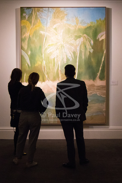 """Sotheby's, London, June 19th 2015. International auctioneers Sotheby's gears up to holding what they say is London's highest valued auction of contemporary artworks, to be held on June 24th 2015 where the combined artworks are anticipated to bring in as much as £203 million. PICTURED: Viewers admire Peter Doig's """"Pelican"""", an oil on canvas painted in 2003-4, which is estimated will fetch betweem £6-8Million.  // Payment/Licencing/Contact details: Paul@pauldaveycreative.co.uk Tel: 07966016296"""